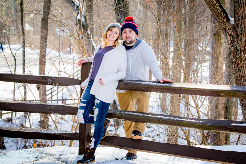 Brittney & Seth's winter engagement photos in Olmsted Falls Ohio at the David Fortier Park. Snowy pictures in front of Covered bridge.