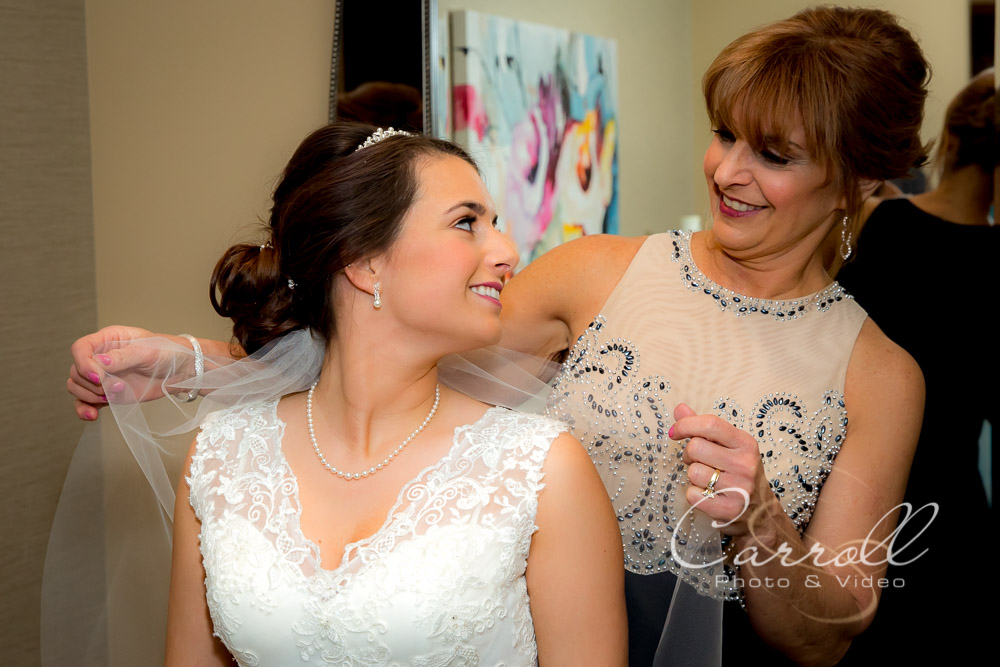 Beautiful Wedding picture of mom putting on brides veil at wedding at The Vineyards at Pine Lake - Columbiana Wedding Photography by Youngstown Wedding Photographers Carroll Photo and Video